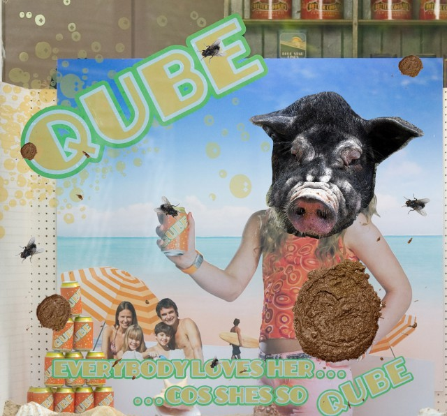 Qube - Ad with pig's head and poo!