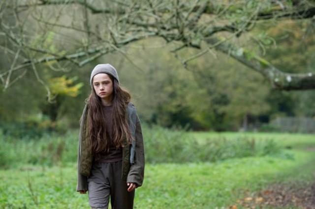 Molly walking in woods - still from movie