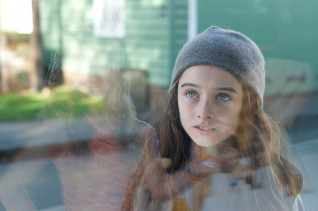Molly stares at Qube ad - still from the movie